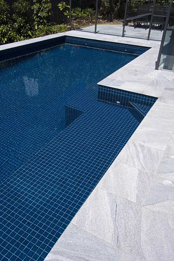 Sandwave granite pool tiles and pavers for Pool tile pictures