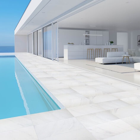 Cararra Marblano® Porcelain tiles around a pool
