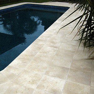 Crema Limestone Antique tiles as pool surround