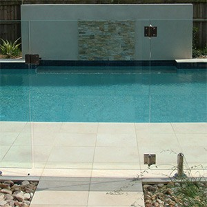 Crema Limestone Antique tiles as pool surround showing water feature