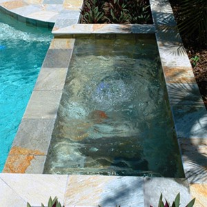 Magnificent Spa with Quartzite Coping and Tiles