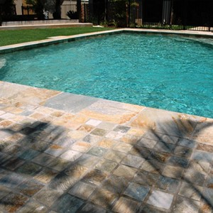 Quartzite Coping with matching Cobblestone Paving