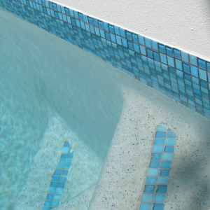 GCR330 Amalfi Glass Mosaics shown as waterline tiles and step marker tiles