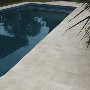 Crema Limestone Pool Tiles in Place